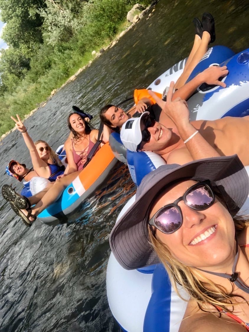 Travel Nurse Shelby, her LRS Healthcare recuriter, Jake Reynoso, and other friends tubing down a river in Reno, NV.