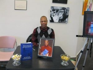 Quinton at a book signing for A Woman in Society